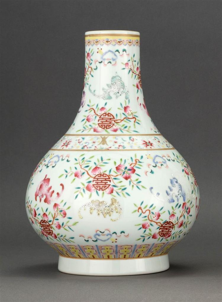 FAMILLE ROSE PORCELAIN VASE In pear shape with bat, fruit, and shou design. Six-character Guangxu mark on base. Height 13