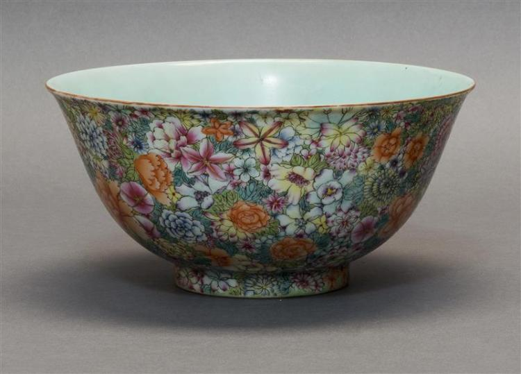 POLYCHROME PORCELAIN BOWL In bell form with Thousand Flowers design. Six-character Qianlong mark on base. Diameter 9