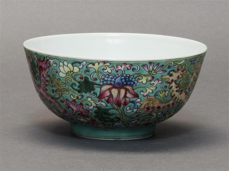 POLYCHROME PORCELAIN BOWL With dragon and flower design on a turquoise ground. Six-character Guangxu mark on base. Diameter 5.5