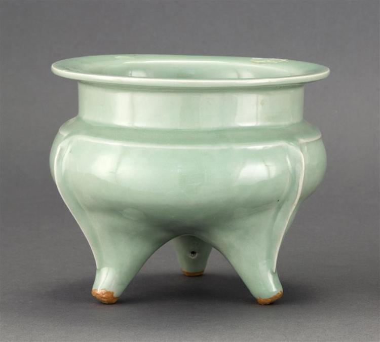 CELADON PORCELAIN CENSER In ovoid form with tripod base and flared rim. Diameter 6.5