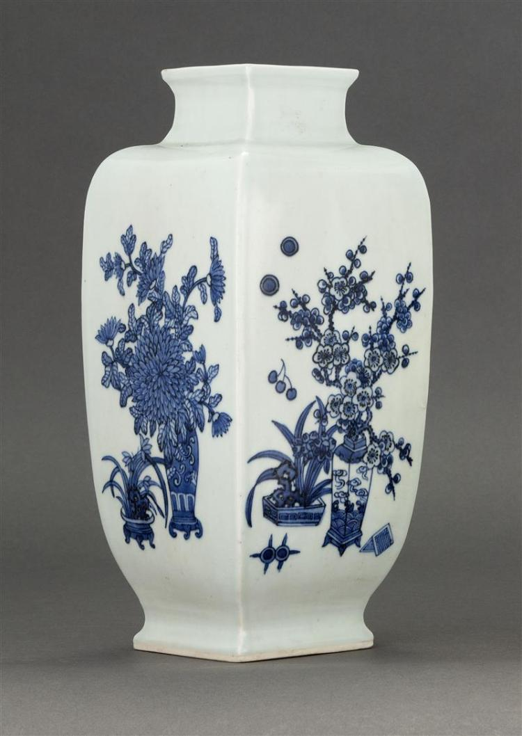 BLUE AND WHITE PORCELAIN VASE In rectangular form with flower vase design. Six-character Qianlong mark on base. Height 11