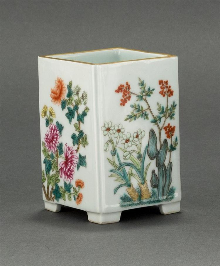 FAMILLE ROSE PORCELAIN BRUSH POT In rectangular form with peony, lotus, narcissus, and chrysanthemum design. Six-character Qianlong...
