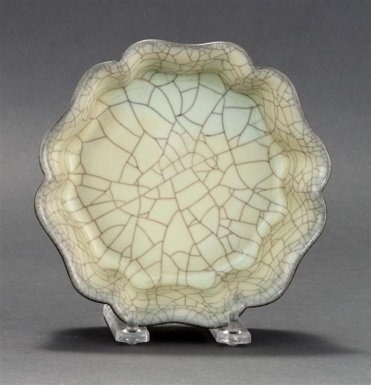 GUAN WARE PORCELAIN BOWL In octagonal floral form with overall crackle glaze. Diameter 6.5