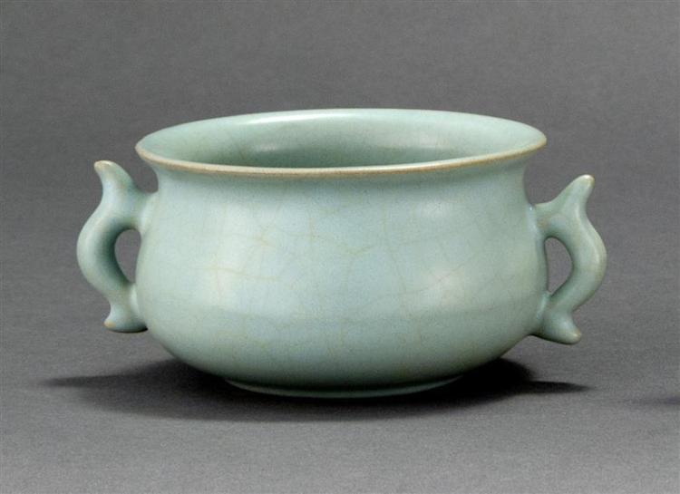 GU WARE PORCELAIN CENSER In ovoid form with stylized dragon handles. Length 5.5