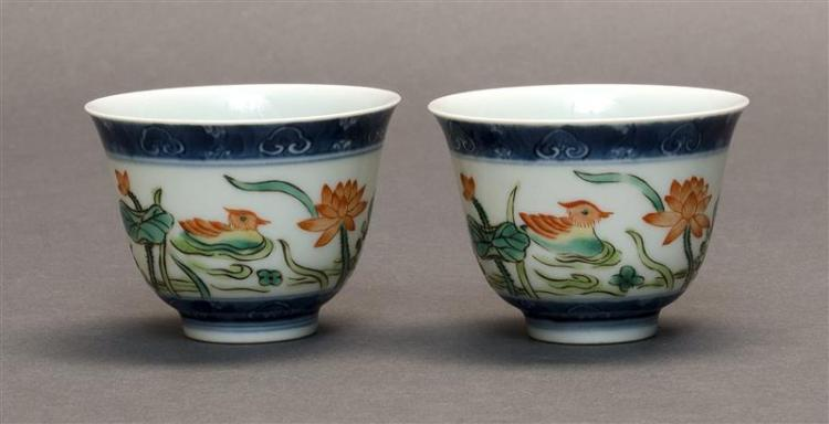 PAIR OF UNDERGLAZE BLUE AND ENAMEL-DECORATED WINE CUPS With mandarin duck and lotus design. Six-character Qianlong mark on base. Dia...