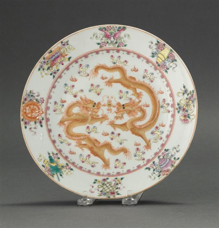 FAMILLE ROSE PORCELAIN PLATE With five-claw dragon design surrounded by pahua motif. Six-character Jiaqing mark on base. Diameter 9
