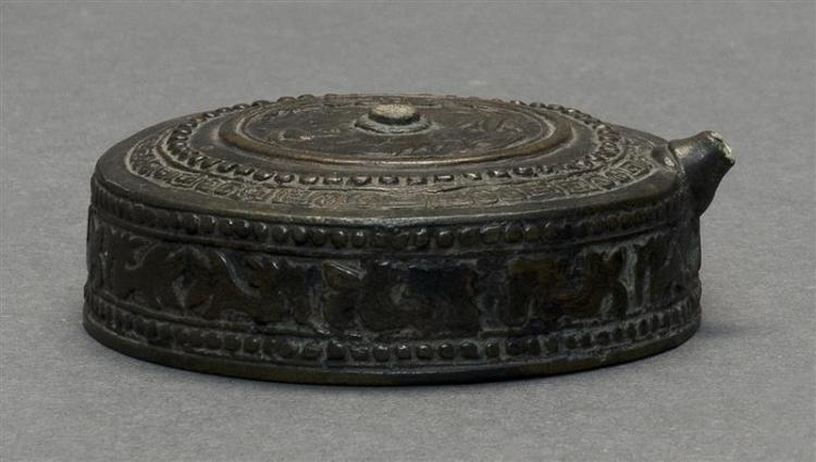 BRONZE SUITEKI In circular form with stylized floral design. Diameter 2.75