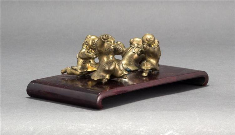 COLLECTION OF FOUR BRONZE KARAKO FIGURES In varying postures with gilt and inlaid metalwork details. Lengths approximately 3