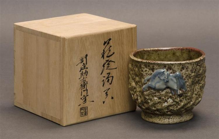 SHINO POTTERY CHAWAN With relief horse design on an irregular ground. Horse design on interior. Diameter 3.5