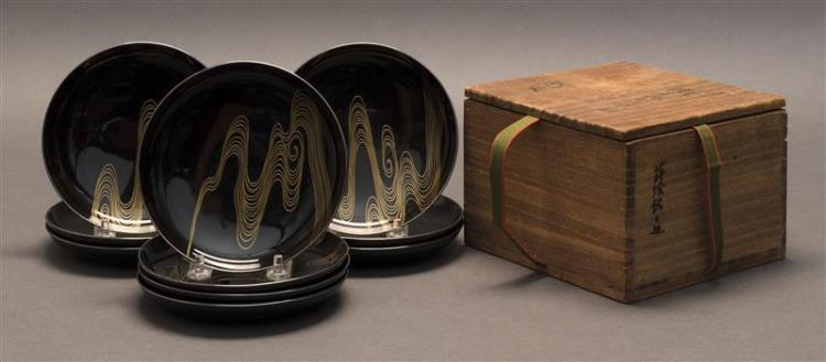 TEN BLACK AND GOLD LACQUER DISHES In a wave design. Diameters 5.25
