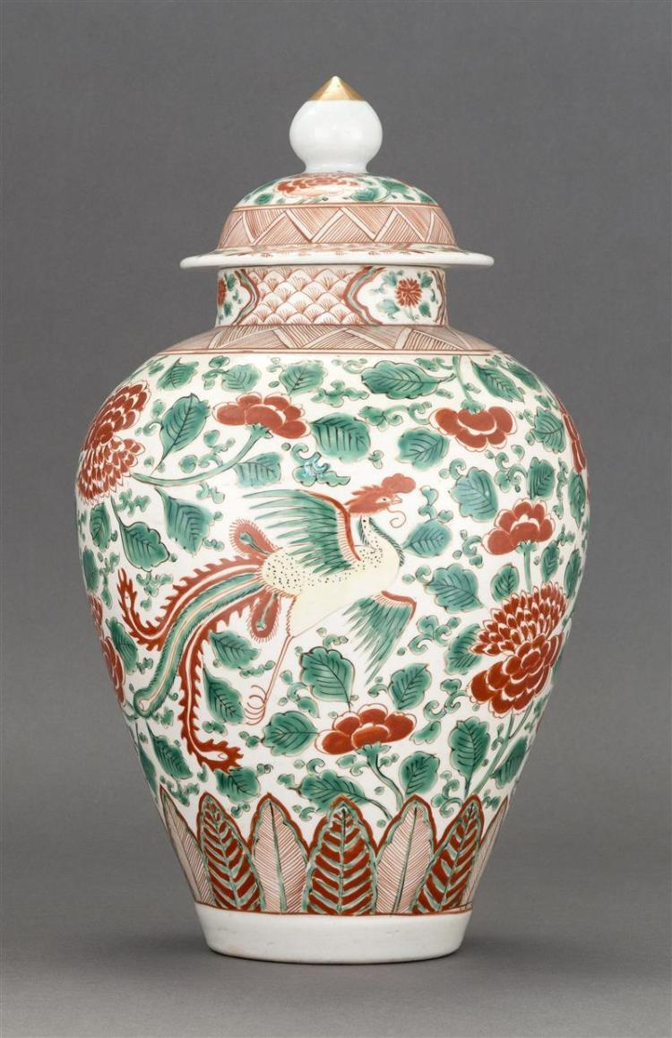 SANCAI PORCELAIN JAR In inverted pear shape with phoenix and peony design. Domed cover with onion finial. Height 13.5