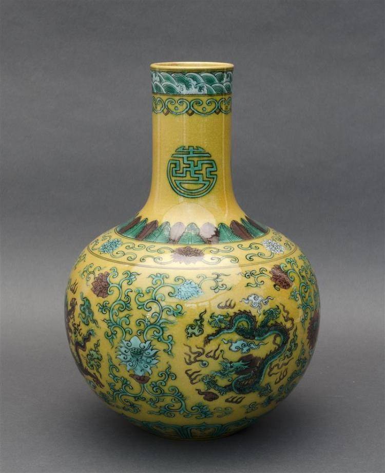 THREE-COLOR PORCELAIN VASE In ovoid form with five-claw dragon and lotus design in aubergine and green on a yellow ground. Six-chara...