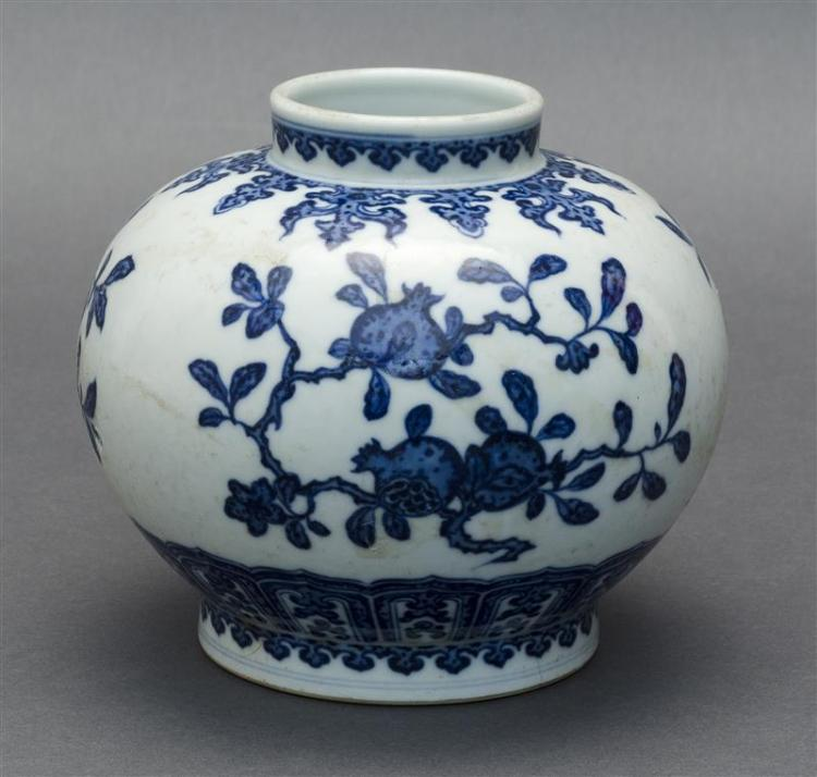 BLUE AND WHITE PORCELAIN JAR In ovoid form with fruit and branch design. Six-character Qianlong mark on base. Height 4.6