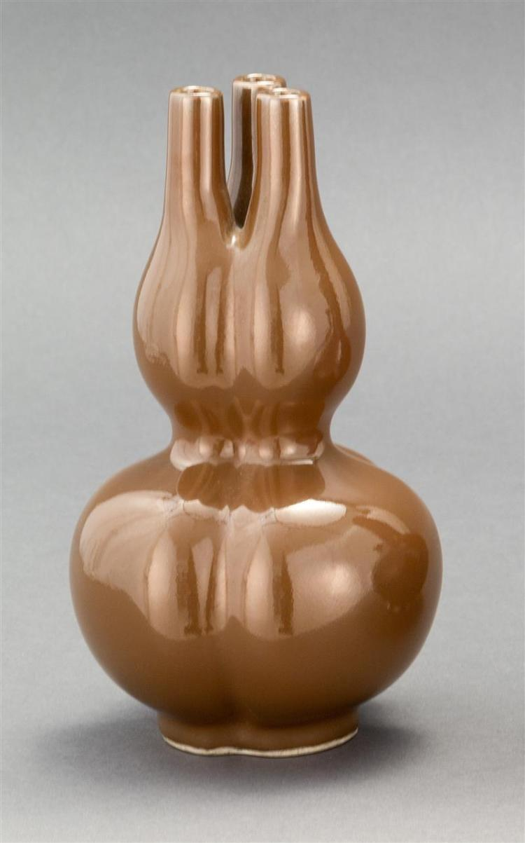 CAFÉ-AU-LAIT GLAZE PORCELAIN VASE In the form of three conjoined gourds. Six-character Qianlong mark on base. Height 8.25