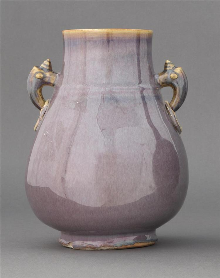 LAVENDER GLAZE PORCELAIN VASE In pear shape with dragon''s-head and mock ring handles. Four-character Yongzheng mark on base. Height...