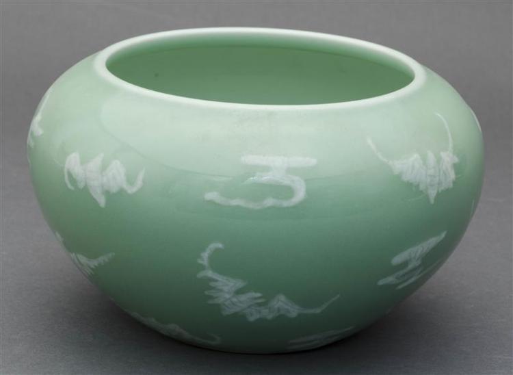 PÂTE-SUR-PÂTE PORCELAIN JAR In ovoid form with white bat design on a celadon ground. Six-character Qianlong mark on base. Diameter 7