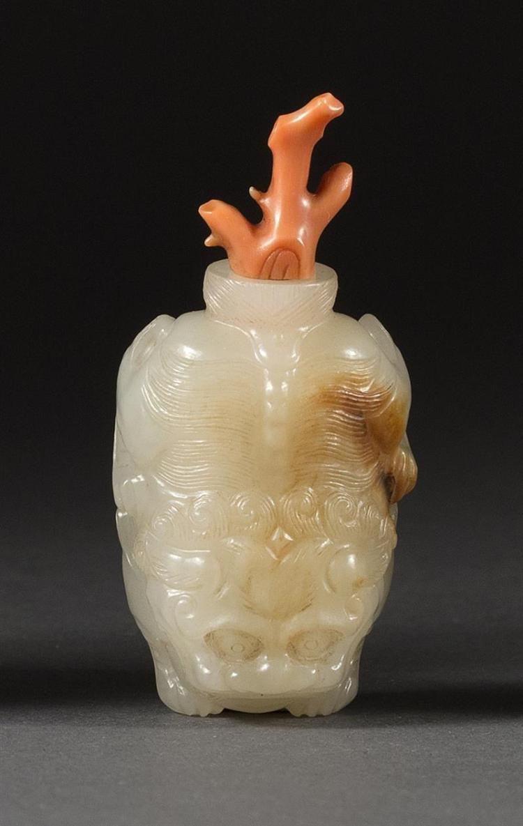 WHITE AND RUSSET JADE SNUFF BOTTLE In qilin form. Length 1.8