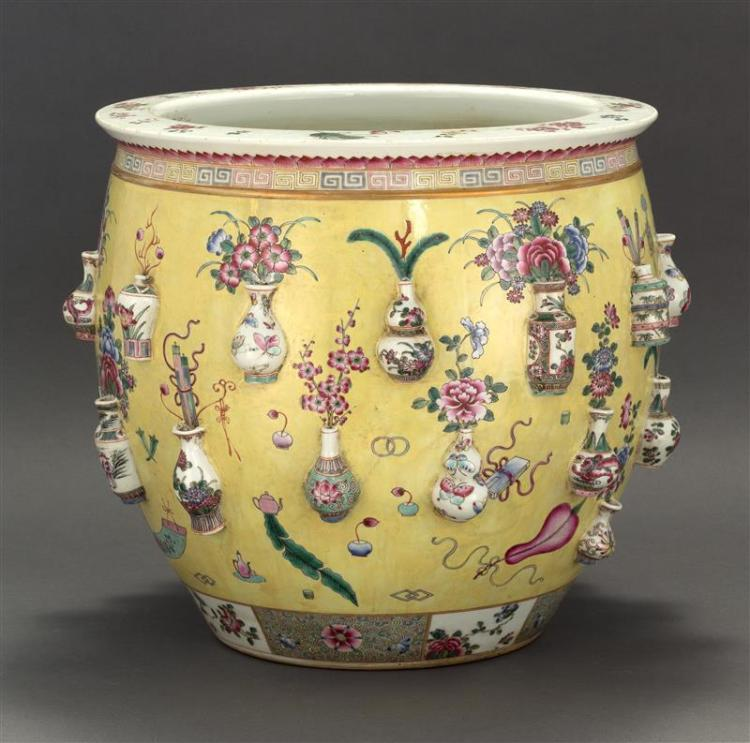 POLYCHROME PORCELAIN JARDINIÈRE With relief-decorated flower vase design on a yellow ground. Diameter 15.5