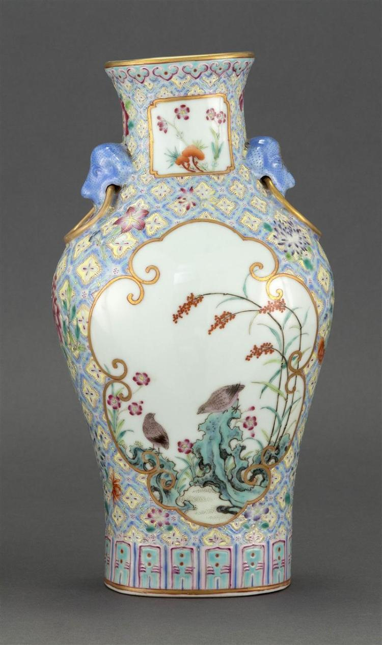POLYCHROME PORCELAIN VASE In inverted pear shape with lion''s-head and mock ring handles. Body decorated with quail and magpie cartou..