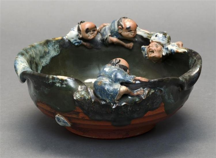 SUMIDAGAWA PORCELAIN BOWL With relief decoration of four figures and a large fish. Gourd-form seal mark. Diameter 7.25