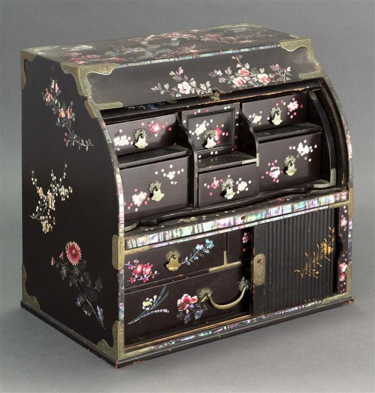 MOTHER-OF-PEARL INLAID BLACK LACQUER CABINET In the form of a roll-top desk. With tambour door in lower case. Upper section with six...