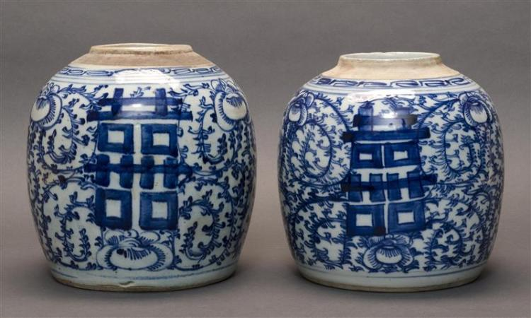 PAIR OF BLUE AND WHITE PORCELAIN JARS In ovoid form with flower and shou design. Heights 8.5