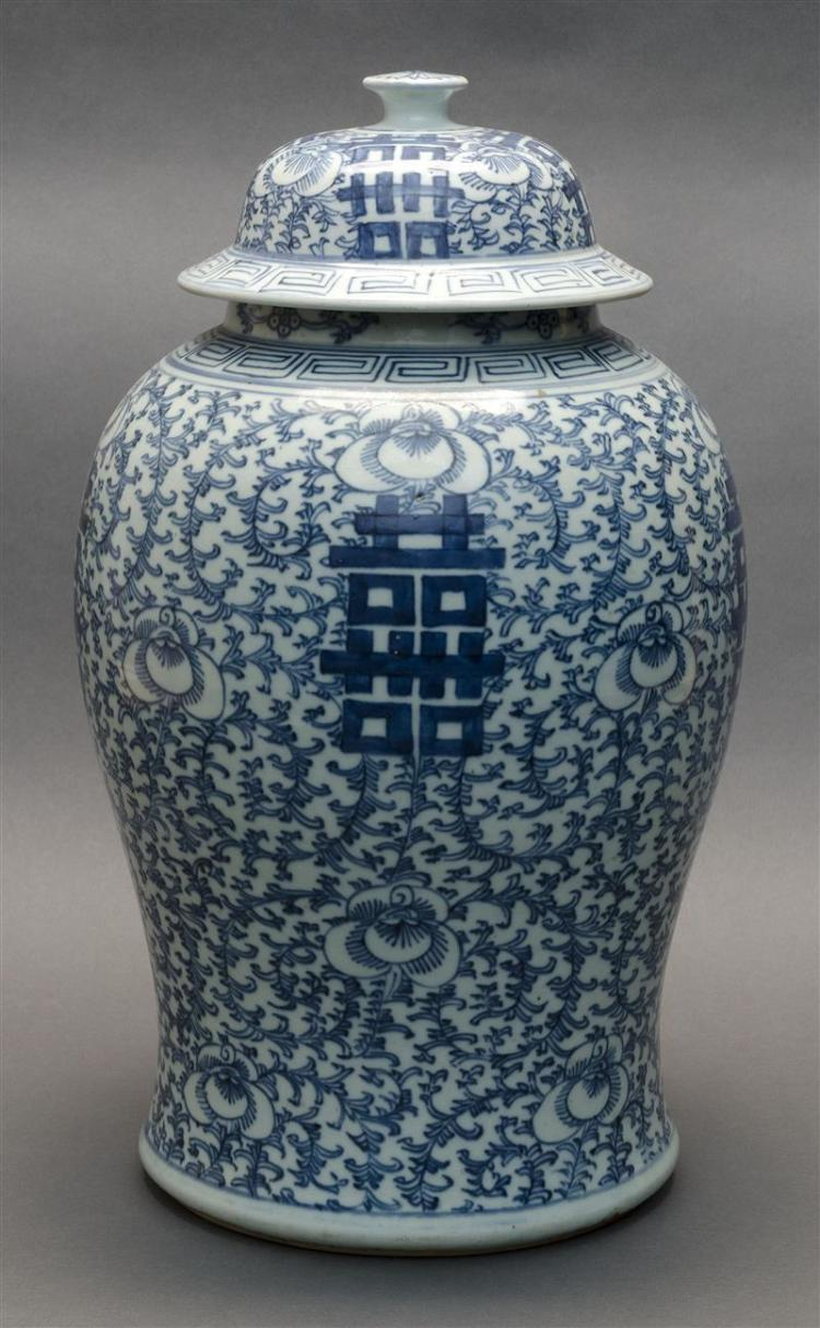 BLUE AND WHITE PORCELAIN COVERED JAR In inverted pear shape with domed cover. Body with flower and shou design. Height 18