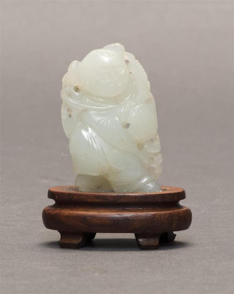 WHITE JADE PENDANT In the form of a child carrying a basket. Height 1.8