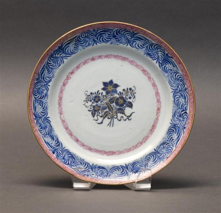 PORCELAIN PLATE With blue floral center surrounded by pink borders. Diameter 8