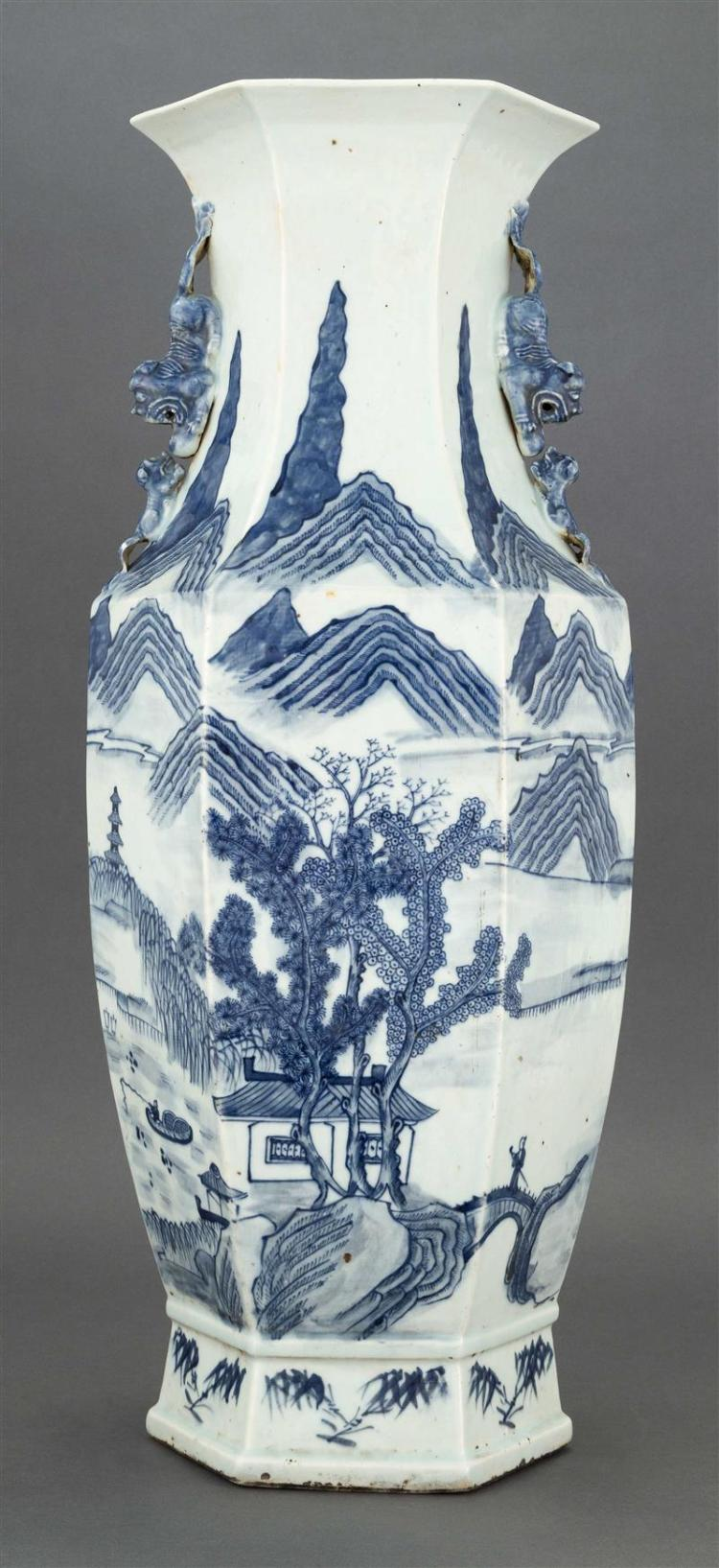 BLUE AND WHITE PORCELAIN VASE In hexagonal form with lion handles and landscape decoration. Height 23.5