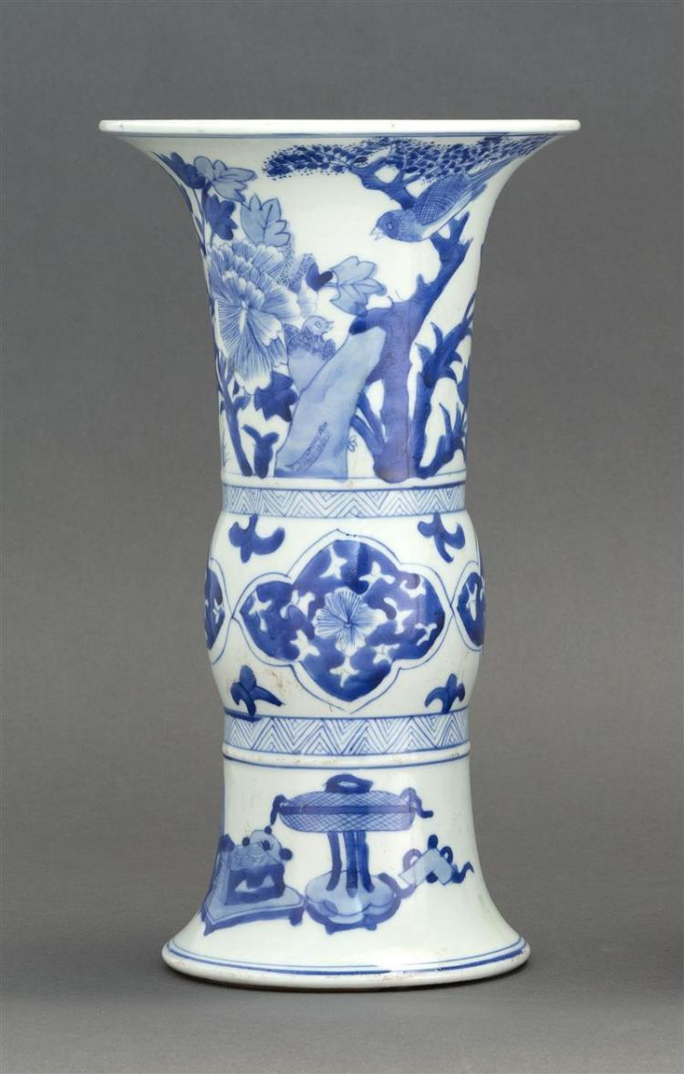 BLUE AND WHITE PORCELAIN VASE In trumpet form with decoration of scholar''s items and flowers. Four-character Kangxi mark on base. He..