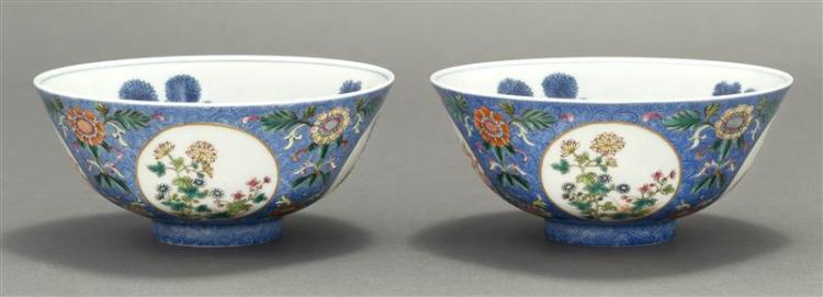 PAIR OF POLYCHROME PORCELAIN BOWLS With underglaze blue floral interior. Exterior with floral cartouches on a blue sgraffito ground....