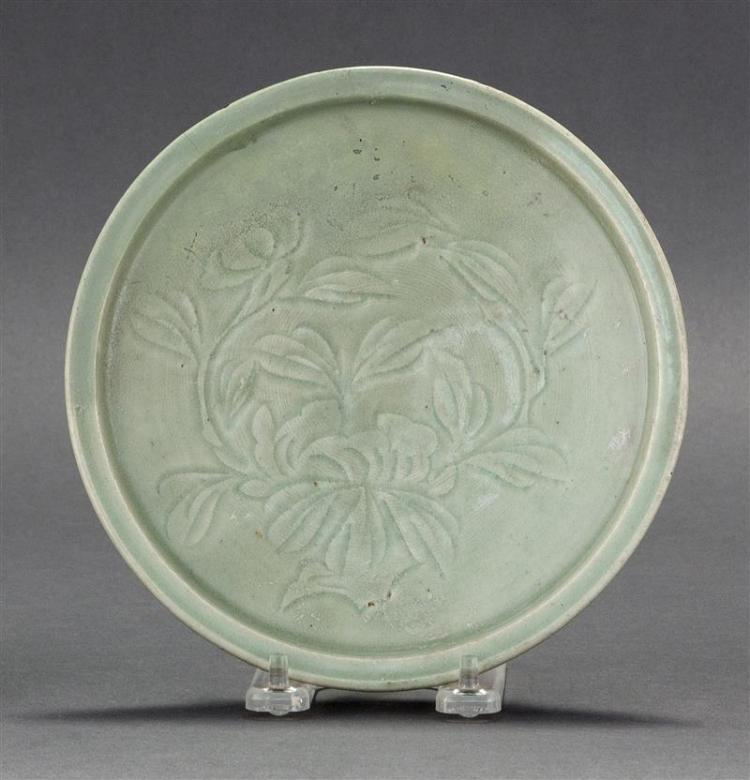 CARVED CELADON FOOTED DISH With peony design. Diameter 7.4