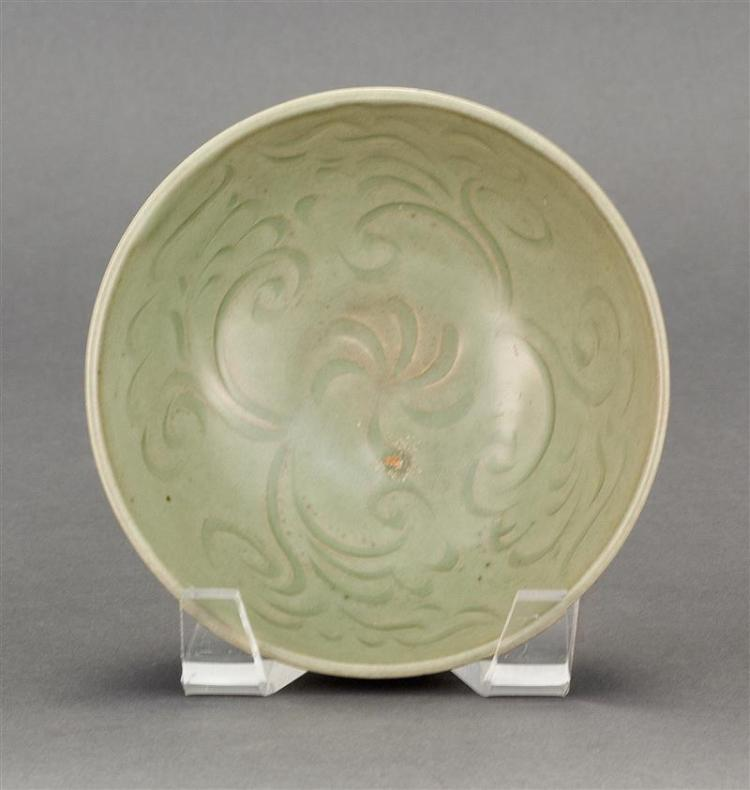 CARVED CELADON BOWL In bell form with incised floral design on interior. Ribbed exterior. Diameter 5.5