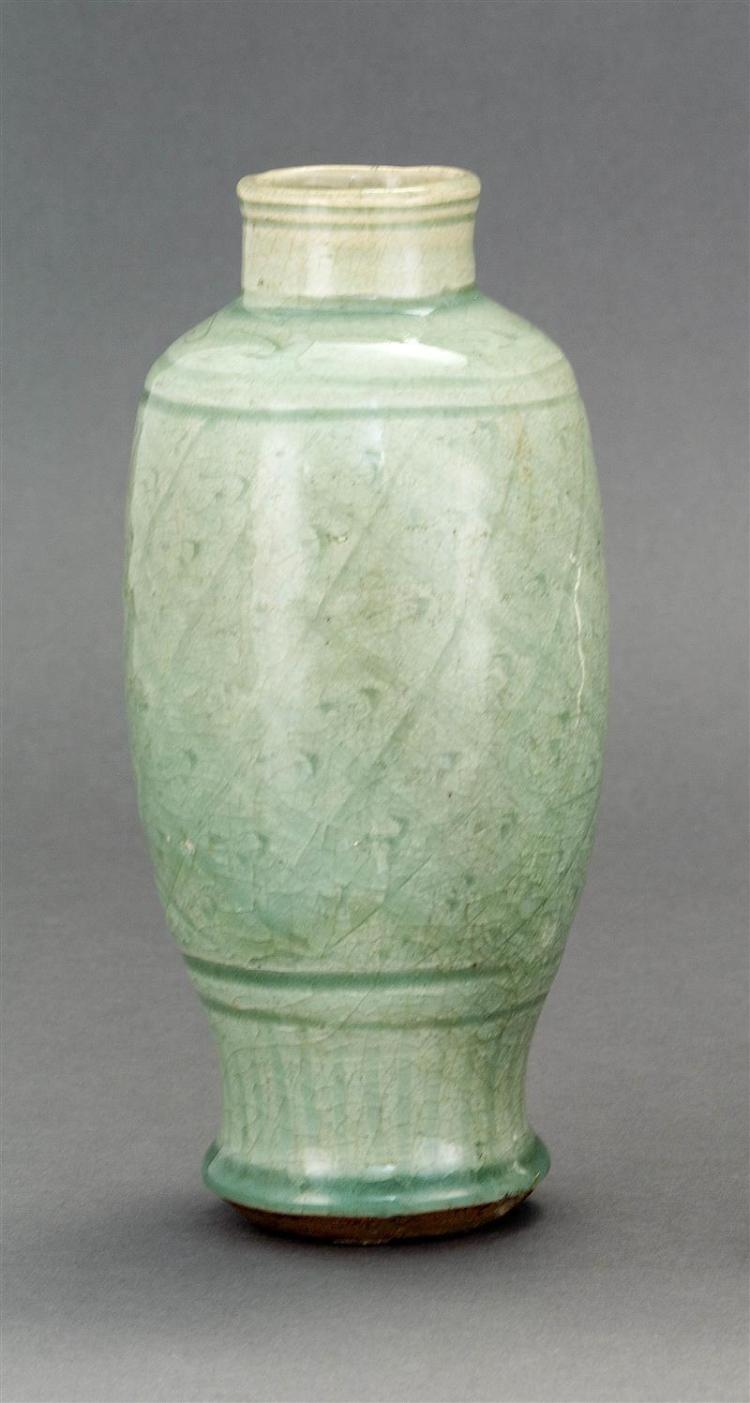 CELADON STONEWARE VASE In baluster form with latticework floral design. Height 8.5