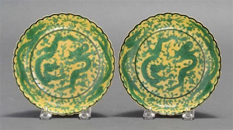 PAIR OF SPINACH AND EGG GLAZE PORCELAIN DISHES In flower form with green five-claw dragon design on a yellow ground. Six-character Q...