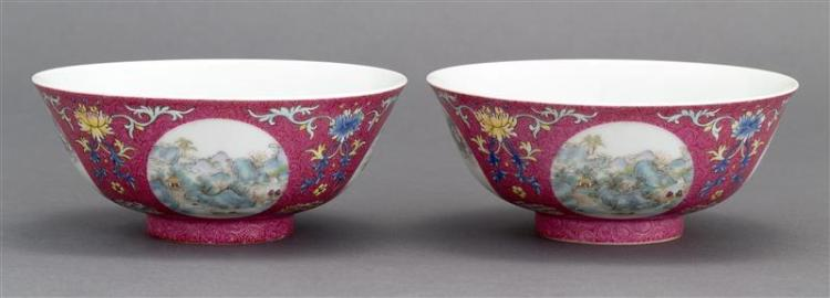 PAIR OF POLYCHROME PORCELAIN BOWLS In bell form with floral interior. Exterior with landscape cartouches on a pink sgraffito ground....