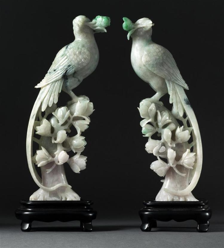 PAIR OF GREEN JADEITE BIRD FIGURES Each perched on a tree stump with flower blossoms. Rich emerald green highlights. Height 11.5