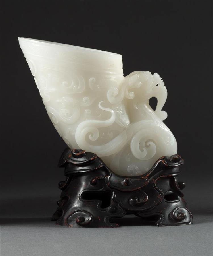 WHITE JADE LIBATION CUP In rhyton form with dragon carving. Length 6.75