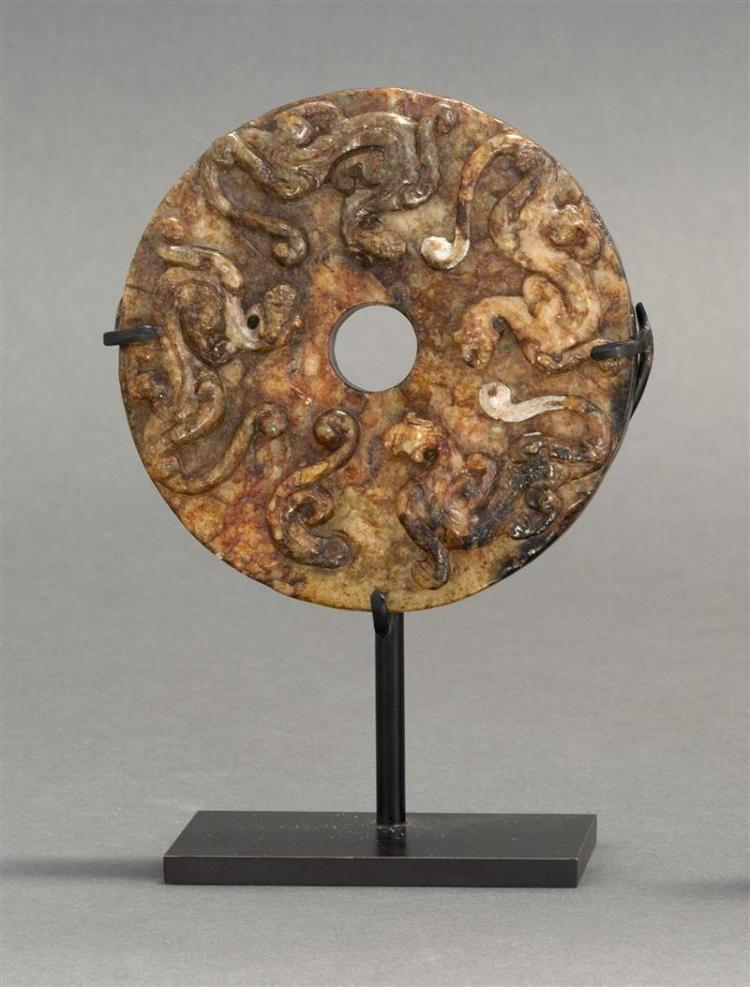 RUSSET JADE BI With relief qilong dragon design. Diameter 4.4