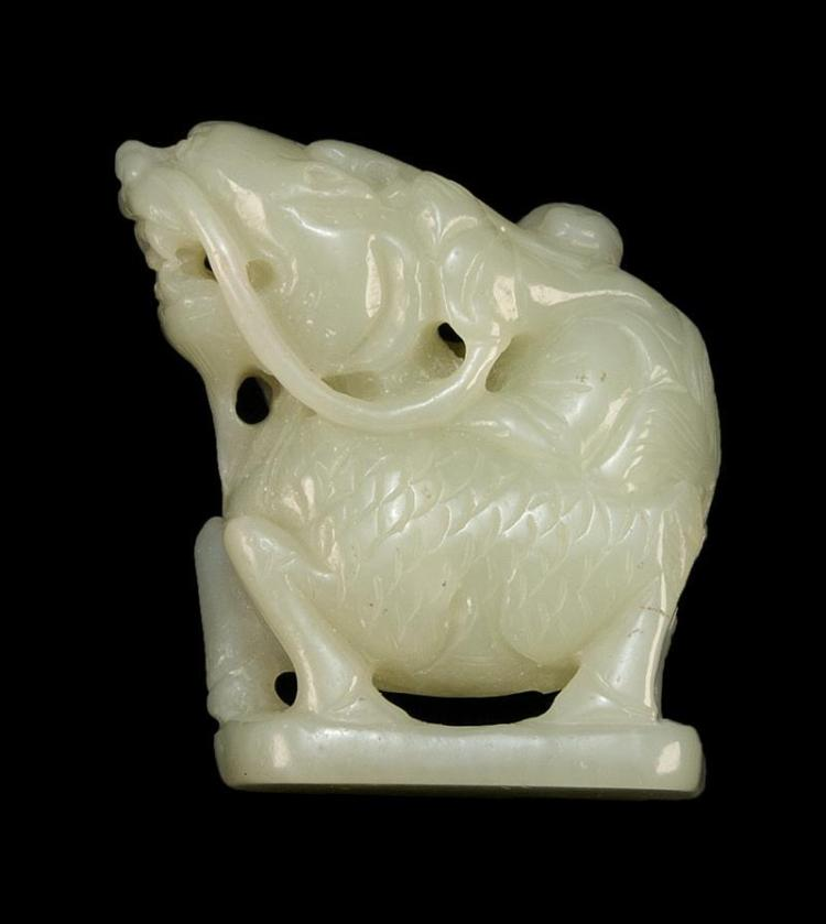 WHITE JADE CARVING In the form of a figure riding on a qilin. Height 2