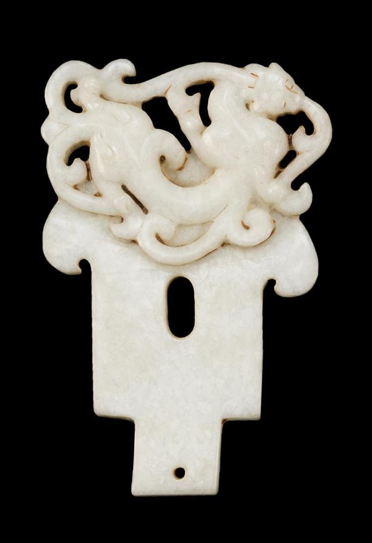 WHITE JADE PENDANT In the form of a dragon and axe head. With considerable openwork. Length 3