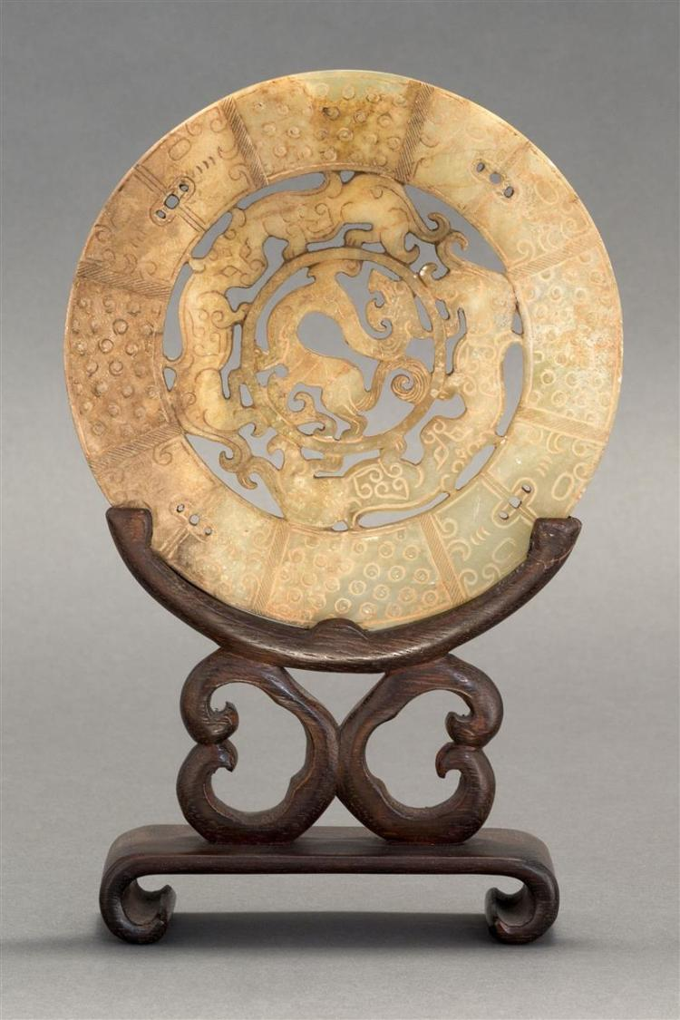 RUSSET AND CELADON JADE BI With pierced design of dragons surrounded by masks and rice pattern. Diameter 6.2