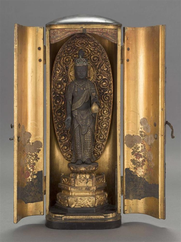 BLACK LACQUER BUTSUDAN Opens to reveal a standing figure of Buddha flanked by two gilt chrysanthemum-decorated doors. Height 18