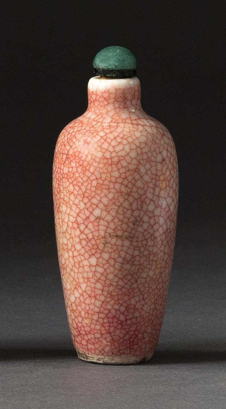 PORCELAIN SNUFF BOTTLE In urn form with red crackle glaze. Height 2.75