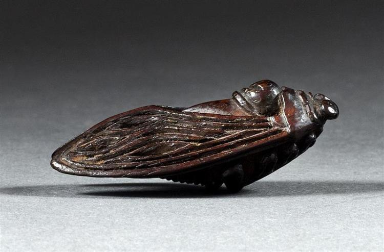 EBONY NETSUKE In the form of a cicada with folded wings. Length 2