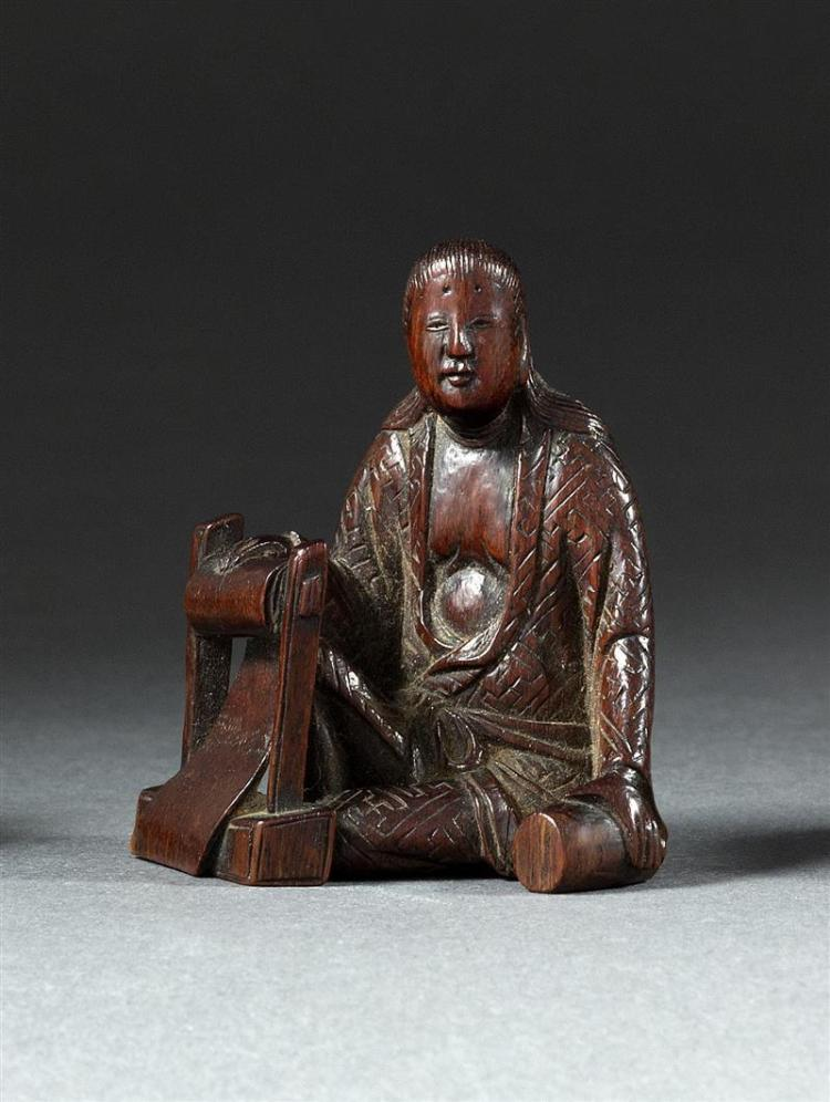 WOOD NETSUKE By Hoju. Depicting a seated woman beating silk. Height 2