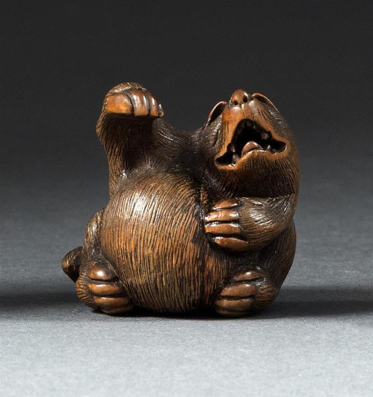 WOOD NETSUKE By Kokei. In the form of a humorous singing badger. Signed. Height 1.3