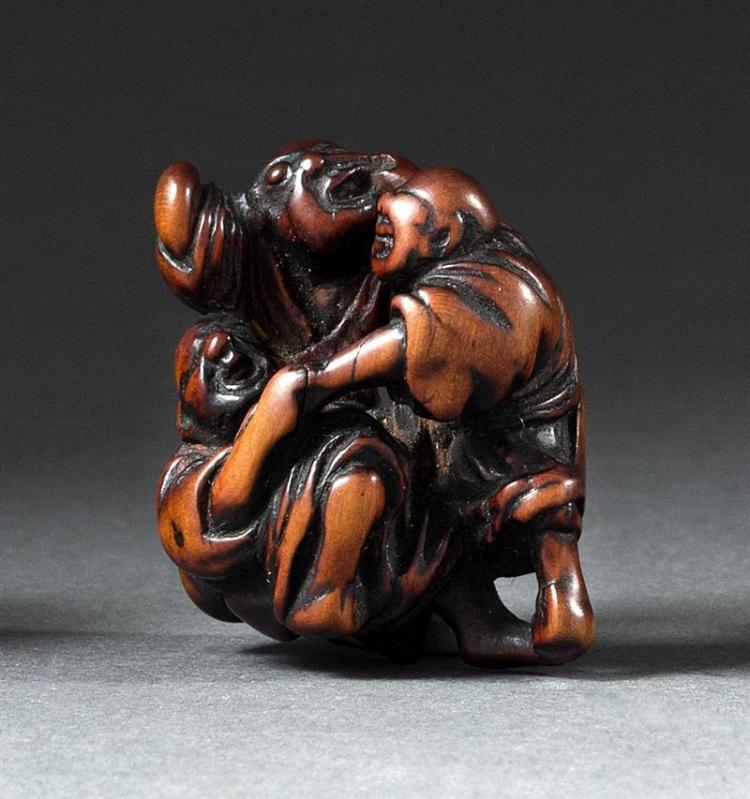WOOD NETSUKE In the form of three blind men grabbing at each other. Height 1.5