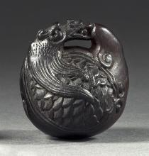 EBONY NETSUKE By Kosai. In the form of a mokugyo bell with dragon handle. Signed. Height 1.6